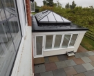 Bespoke white painted seasoned oak orangery and roof lantern in Hertfordshire