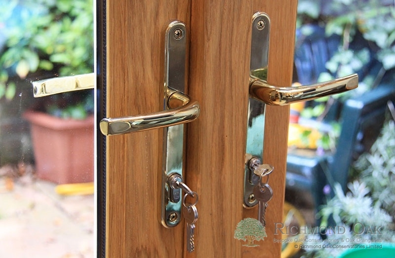 07_Charalambous_Oak_Orangery_gold_door_handles-213